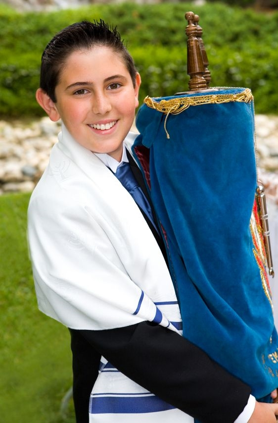 Jewish boys and girls embrace the responsibility of carrying the Torah for the first time on the day of their Bar and Bat Mitzvah, when they officially become sons and daughters of the Commandment.