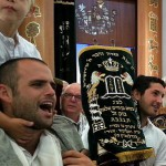 Holding one of 11 sacred Torah scrolls in a Tel Aviv synagogue this morning on Simchat Torah