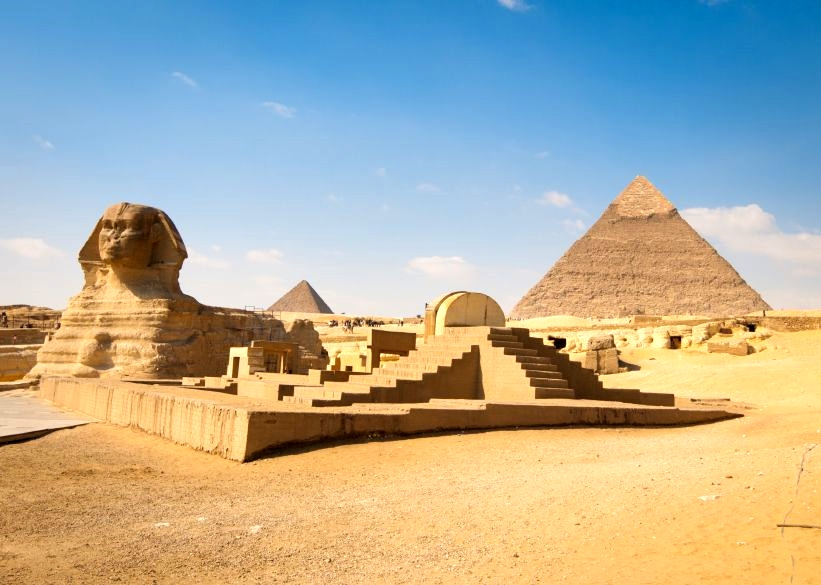 The Great Sphinx of Giza (left) and pryramids.