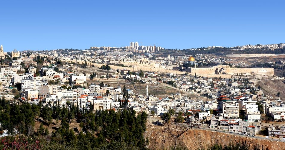 A view of the Old City of Jerusalem extending from Mount Zion at the left edge of the frame to the corner of the Temple Mount near the right edge.