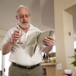 A Jewish man reads from the Passover Haggadah during the Seder