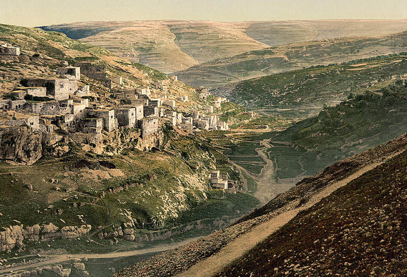 Silwan in the late 19th century with houses built directly on top of  the cave tombs, left of the center.
