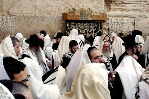 Jewish men pray at the Western (Wailing) Wall