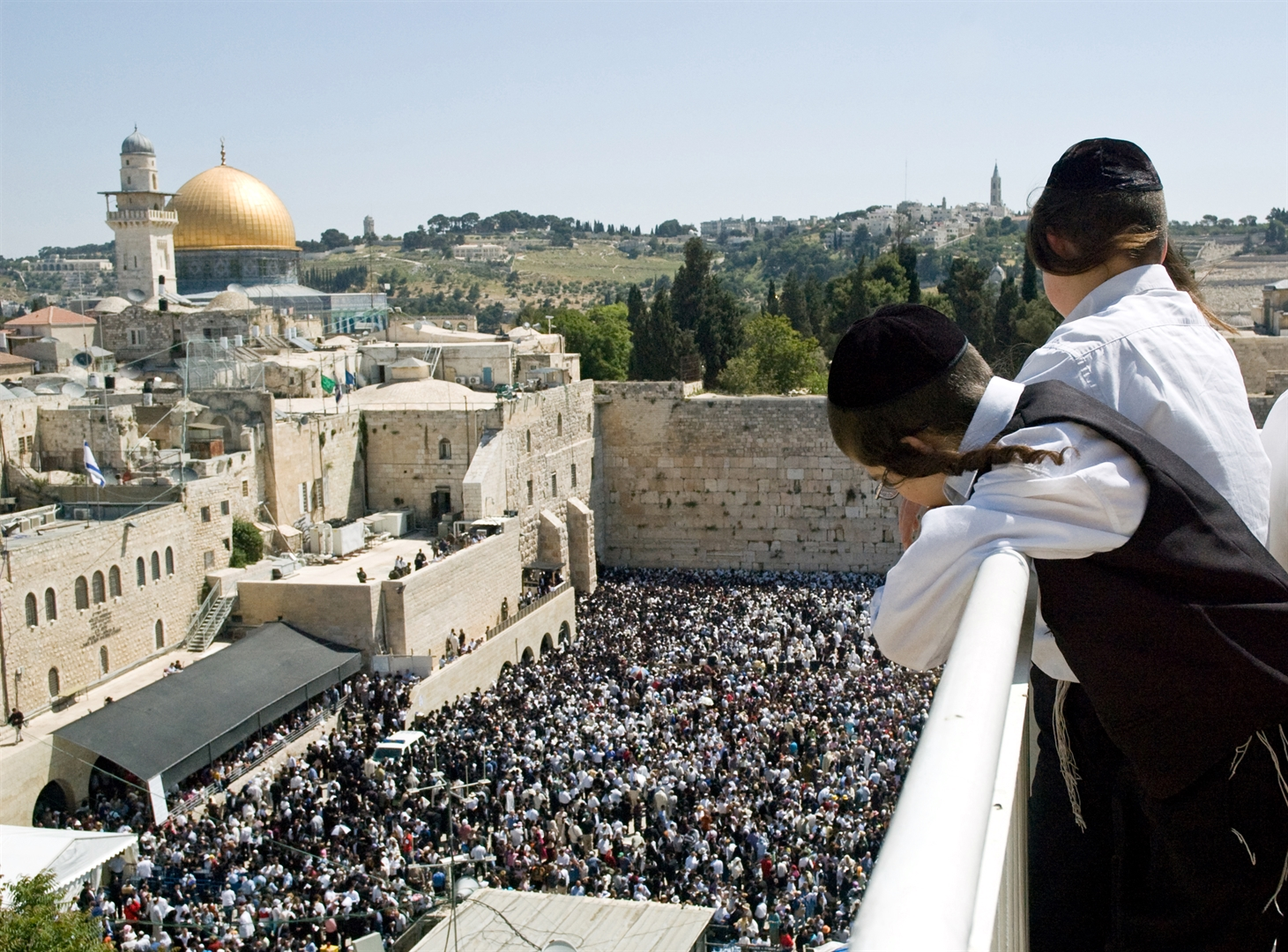 Orthodox Jewish children watch as Israelis gather at the Western (Wailing) Wall for prayer.