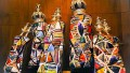 Torah scrolls adorned with keterim (crowns) and rimonim (Torah finials, literally pomegranates)