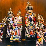 Torah scrolls adorned with keterim (crowns) and rimonim (Torah finials, literally pomegranates)