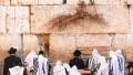 Jewish men pray at the Western Wall Plaza in Jerusalem