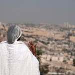 In accordance with King Solomon's prayer, an Ethiopian Jewish woman  prays toward the Temple Mount where the First and Second Temples once stood.