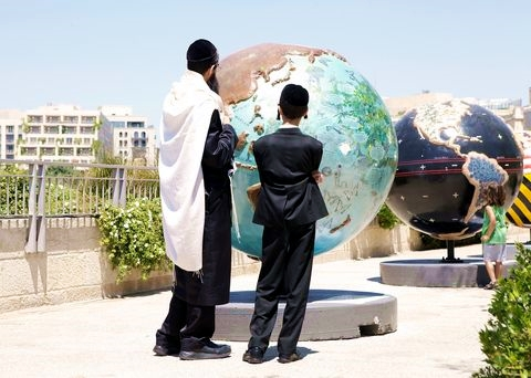 Orthodox father-children-world map-globe
