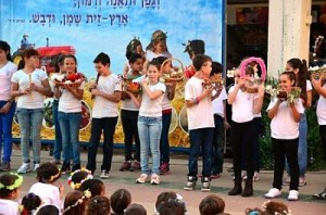 Israeli secular school children celebrate the Jewish holiday of Shavuot (Feast of Weeks), which commemorates the harvest, the Day of the Firstfruits, and the day the Torah was traditionally revealed by God to the Israelites.