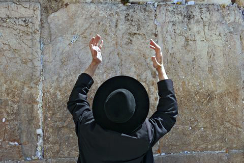 Ultra-Orthodox man-lifting hands-prayer-Kotel-Western Wall