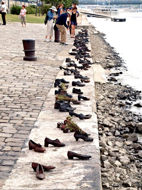 The Shoes on the Danube Promenade is a memorial that honors the Jews who were killed by fascist Arrow Cross militiamen in Budapest during World War II.  Here the Jews were ordered to take off their shoes and then shot at the water's edge so that their bodies fell into the river and were carried away by the current.