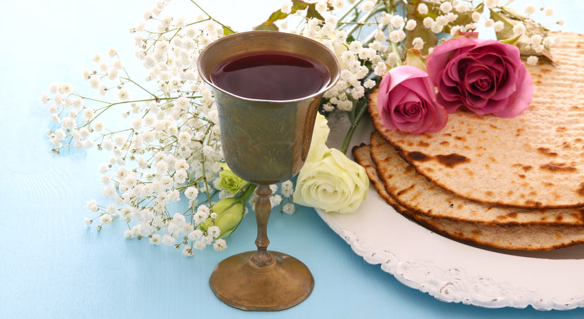 Matzah (unleavened bread) and a goblet of wine are two of the symbolic foods at  Passover.