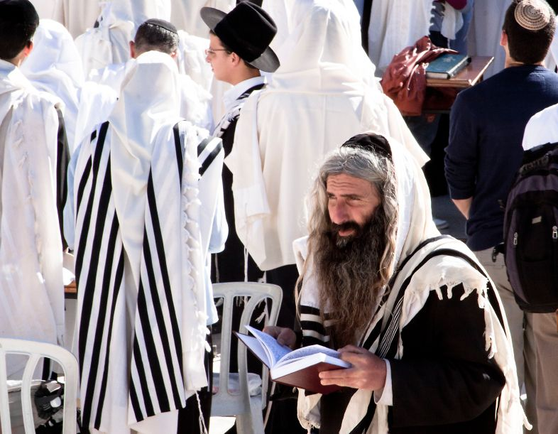 An Orthodox Jewish man prays at the Western (Wailing) Wall at Passover.