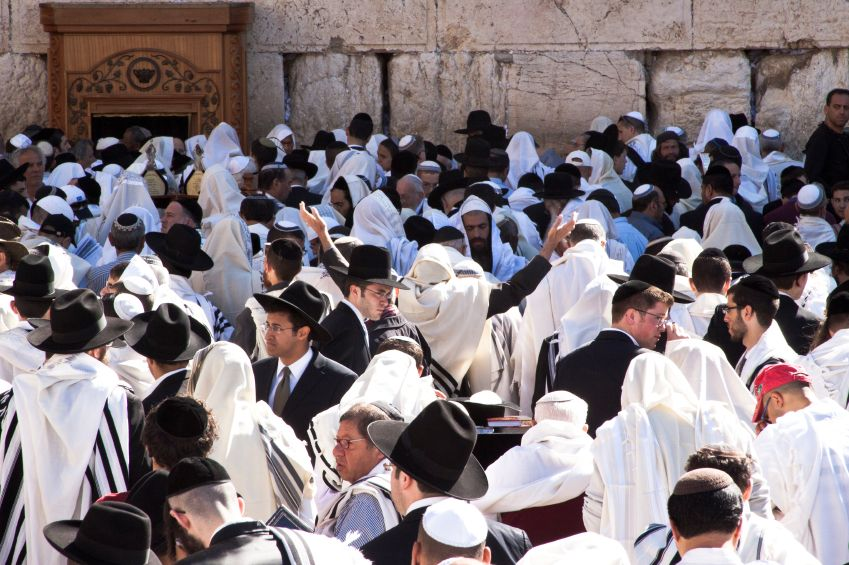Jewish men gather for prayer at the Western Wall during Pesach.