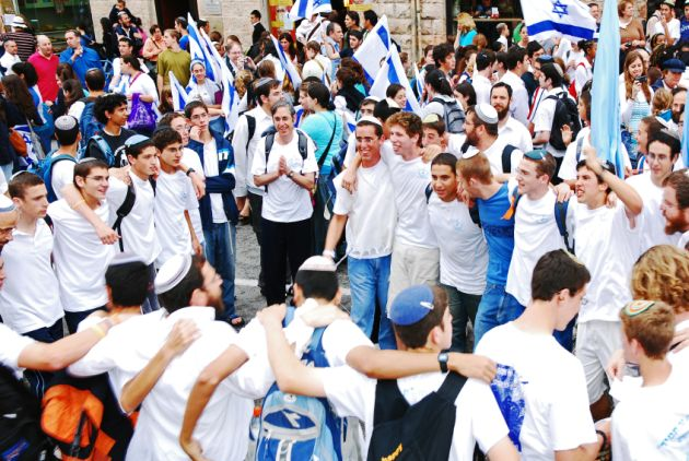 Israelis dance on the street and wave flags on Independence Day.