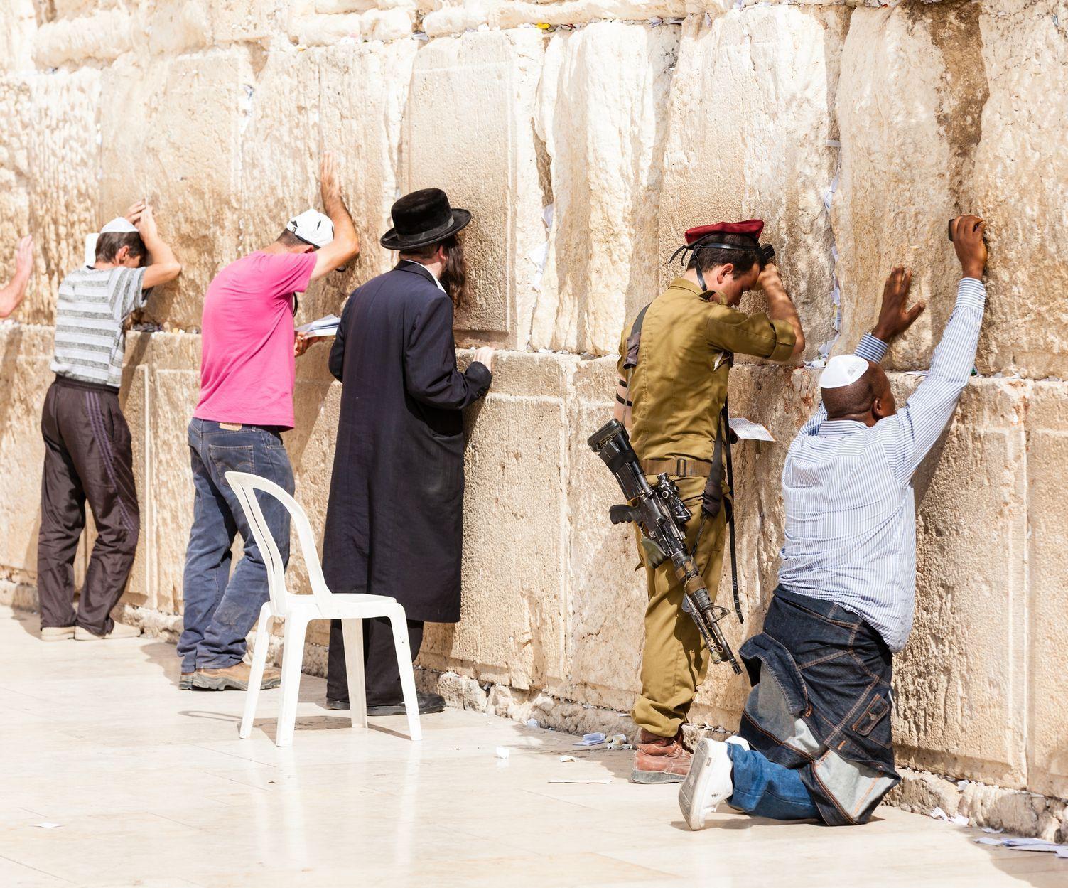 Men pray at the Western (Wailing) Wall in Jerusalem.