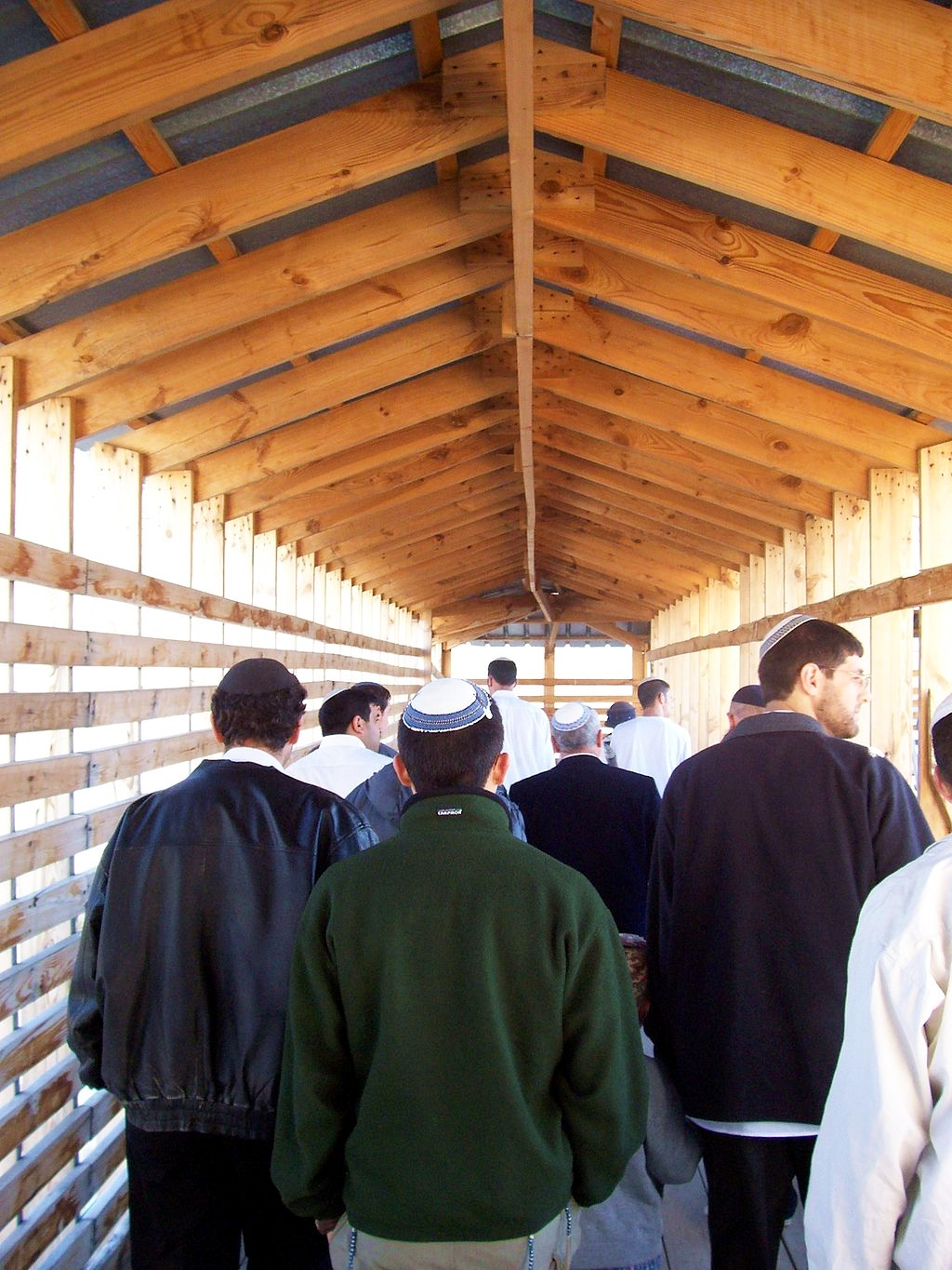 Jewish men enter the Temple Mount through the Mughrabi Gate