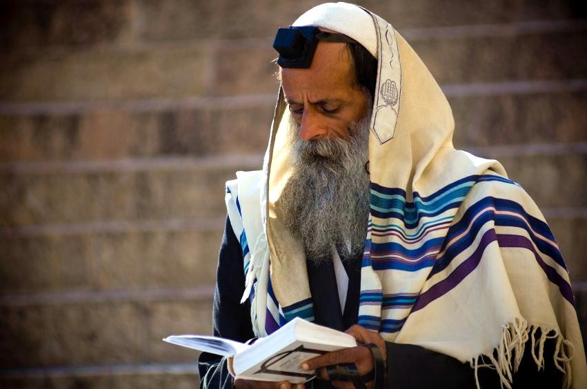 An Orthodox Jewish man recites morning prayers.