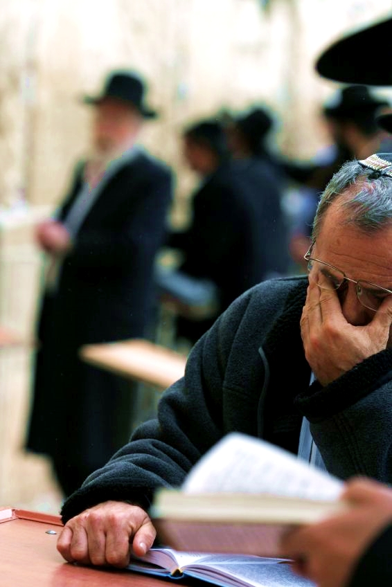 Praying selichot prayers at the Western (Wailing) Wall in Jerusalem.