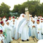 Samaritans lift the Torah on Mount Gerizim during Shavuot, otherwise called Pentecost or the Feast of Weeks.