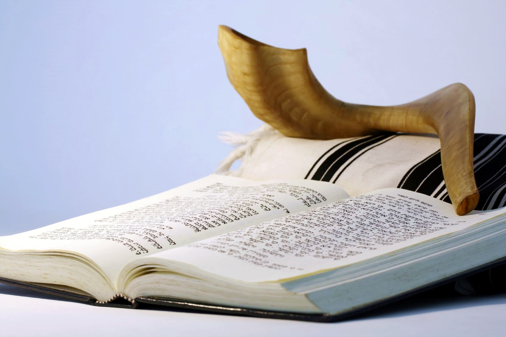 The shofar (ram's horn), which is the object resting on a tallit (prayer shawl), is blown throughout the Hebrew month of Elul in preparation for the High Holy Days, which begin this Wednesday night with Rosh HaShanah (New Year), also called Yom Teruah (The Day of Blowing the Shofar).