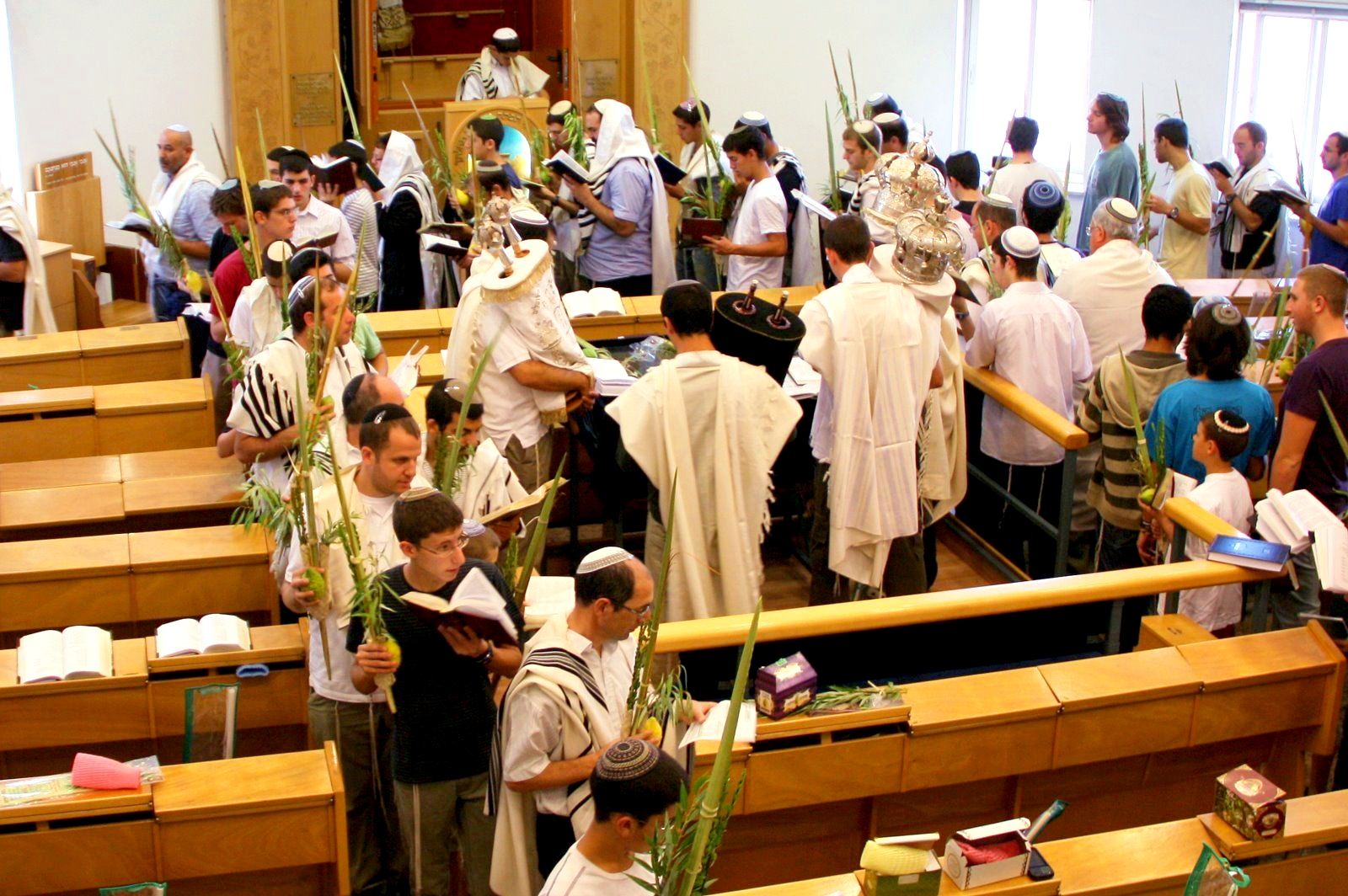 On Hoshana Rabbah, Jewish men encircle the bimah (table where the Torah is read) with palm, willow, myrtle and citron in hand in memory of the circles once made around the altar on the Temple Mount.