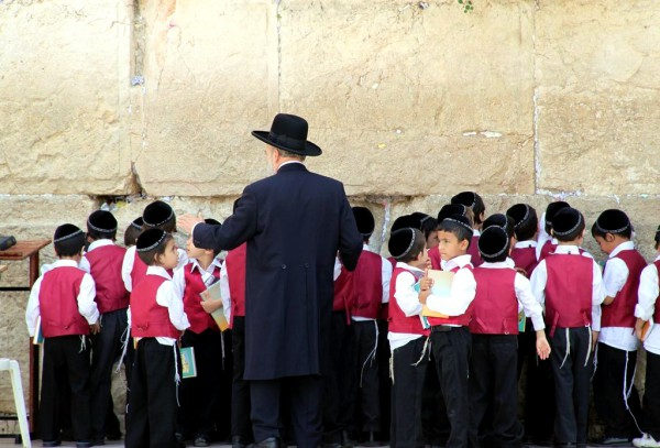 Young Israeli students come to the Western (Wailing) Wall to pray.