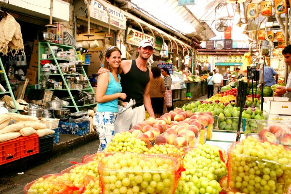A couple shops together in the Mahane Yehuda Market in Jerusalem.