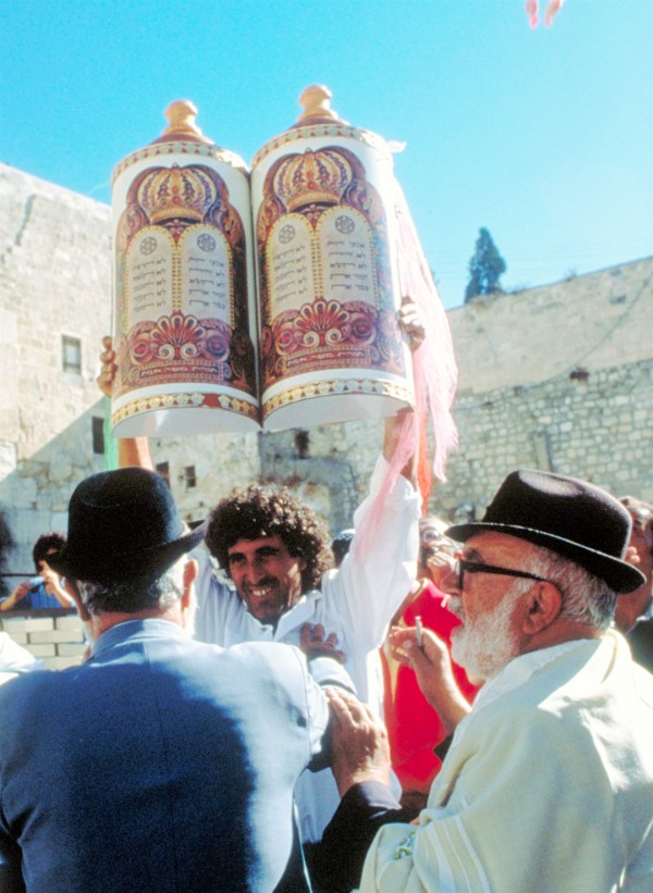 Lifting the Torah for all to see at the Western (Wailing) Wall in the Old City of Jerusalem. (Photo: Israel Ministry of Tourism)
