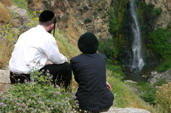 An Orthodox husband and wife take a few moments to enjoy the beauty of nature together.