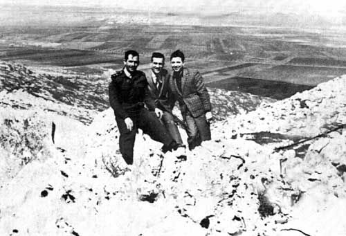 This photo by Syrian military personnel shows Eli Cohen (middle) with his friends from the Syrian army at the Golan Heights overlooking Israel.  Although civilians were not allowed to the Golan Heights since it had been a heavily guarded military area, Cohen was case apart.