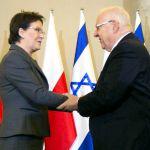 Polish Prime Minister Ewa Kopacz greets Israeli President Reuven Rivlin.