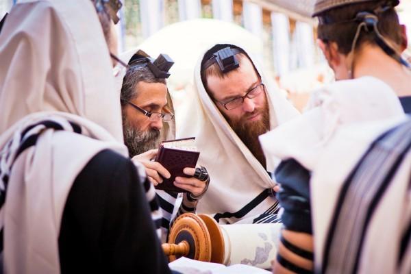 Jewish men pray together in Jerusalem