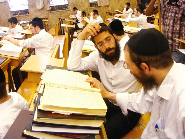 Yeshiva (Orthodox seminary) students in Jerusalem discuss Torah.