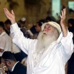 A Jewish man prays at the Western Wall on Yom Kippur.