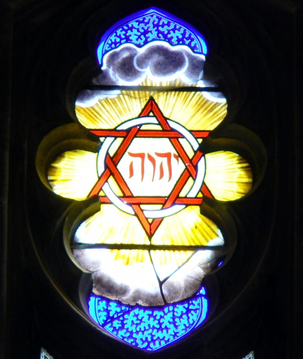 The Tetragrammaton (YHVH) in a stain-glass window in Winchester Cathedral