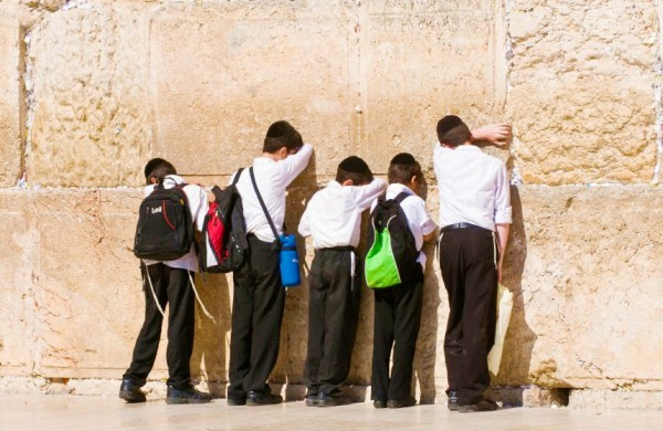 Orthodox Jewish children pray at the Western (Wailing) Wall.
