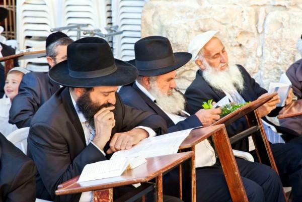 Chasidic Jewish men reading near the Western (Wailing) Wall