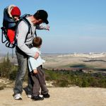 An Israeli father points out the family's hometown during a hike.