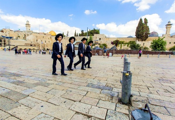 Ultra-Orthodox teens walk together at the Kotel (Western Wall) Plaza in Jerusalem.