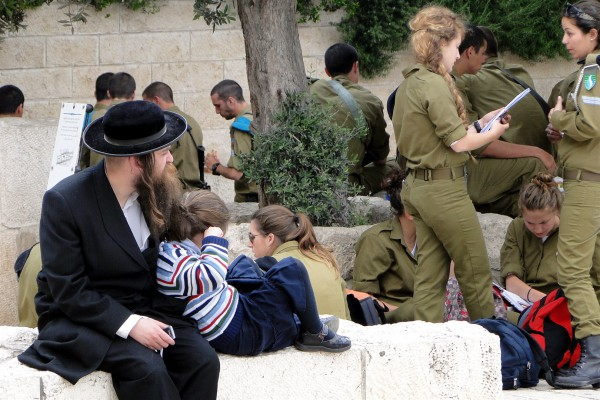 A father sits with his daughter in Jerusalem. Around the two are the young men and women who are called upon to protect Israel from the nation's enemies.