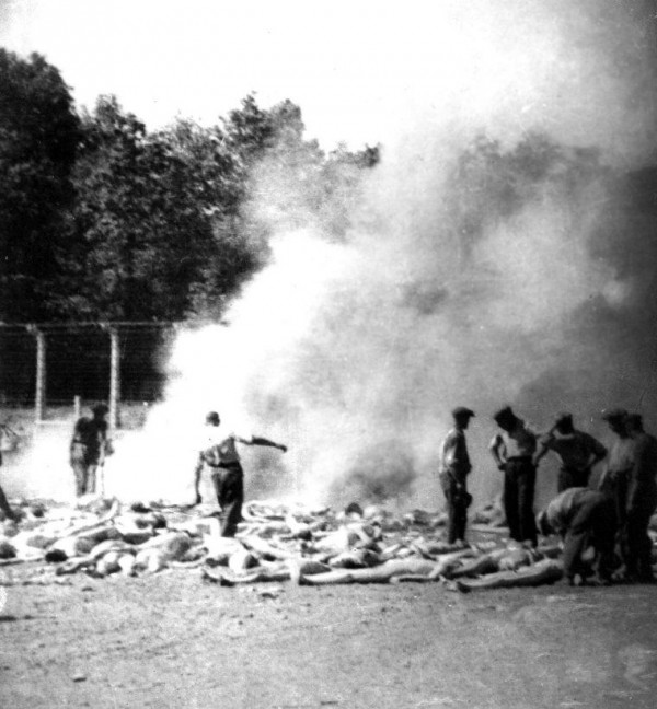 This secret photograph taken by a Sonderkommando is a cropped version of one of four photographs from Auschwitz-Birkenau, part of a series known as the Sonderkommando photographs. This photograph, number 280, shows bodies waiting to be burned in an outdoor fire pit.