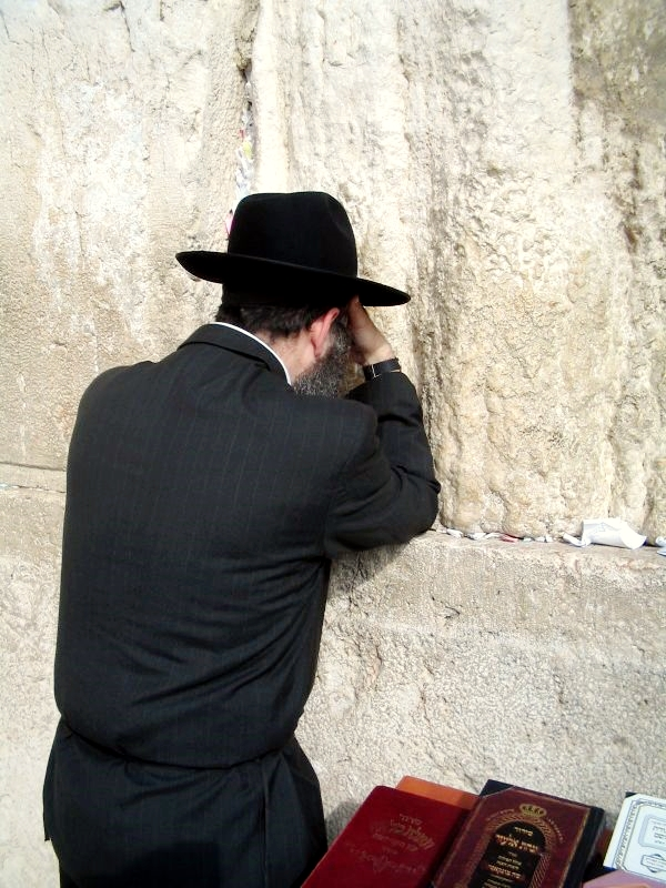 Praying at the Western Wailing Wall Kotel Jerusalem