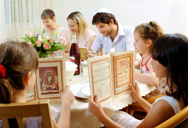 A Jewish family commemorates the Exodus of the Israelites from Egypt at the Passover Seder. The order of this special meal is set forth in the text called the Haggadah (telling). (Go Israel photo by Jorge Novominsky)