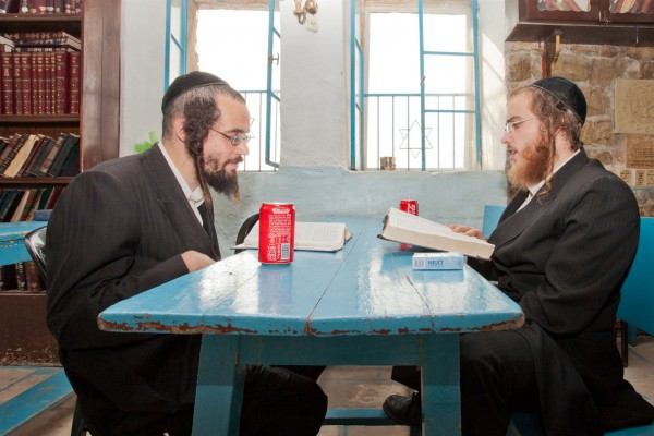Two ultra-Orthodox men study Torah together.
