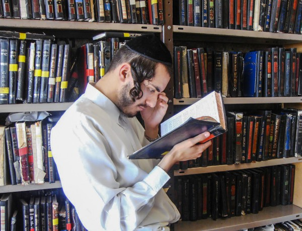 A Jewish man studies at a Yeshiva (Orthodox Jewish seminary) in Jerusalem.