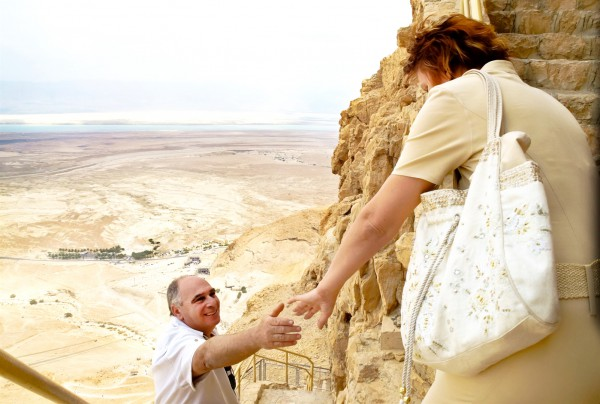 A husband helps his wife down the steps at Masada, which is near the Dead Sea in Israel.