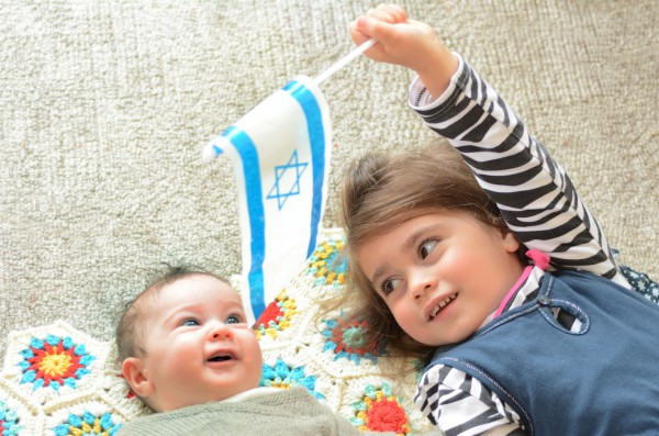 Young Israeli entertains her sibling.