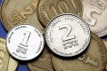 Israeli one and two shekels coins.
